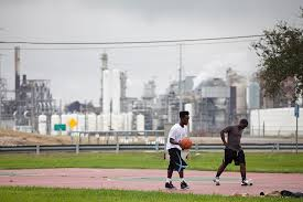 People living in poverty surround the refineries.